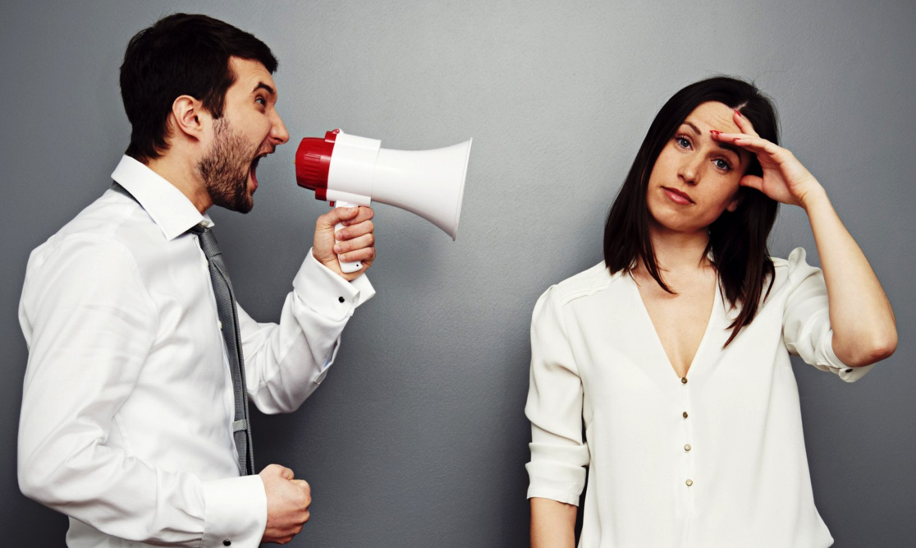 Husband talking to wife using megaphone