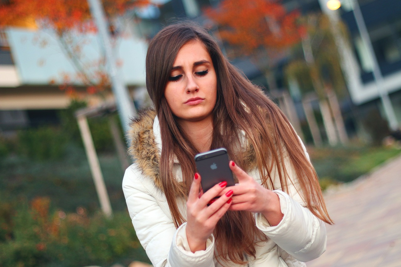 woman reading text message wondering if he's interested in a long-term relationship
